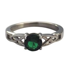 MAY BIRTHSTONE RING EMERALD CZ STONE CELTIC KNOT FASHION BAND. The birthstone for May is emerald. This is a beautiful women's May Celtic knot birthstone, cocktail or everyday fashion ring is made from solid hypoallergenic silver tone surgical stainless steel. The 6mm round emerald colored (dark green) center CZ stone (cubic zirconia). The Celtic knot band is 2mm wide with a silver tone high polish finish. Available in size 5, 6, 7, 8, 9 or 10.