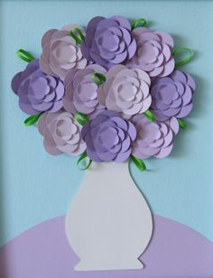 Paper flower bouquet. Cute for mother's day with pictures of kids smiling faces in flowers.