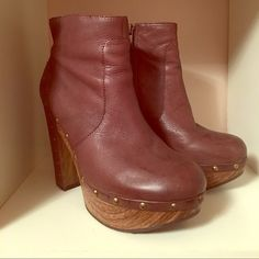 Chunky Heeled ankle booties Brown leather clog style ankle bootie by Lucky Brand. Wooden platform with a covered heel and stud accents. Slight creasing of leather towards the front with slight discoloration on left boot. Heels & soles are in excellent condition. Lucky Brand Shoes Ankle Boots & Booties