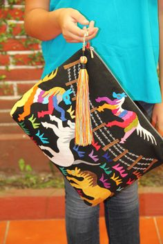 Black and multi colored Clutch Vegan by CasaOtomi on Etsy Mexico, Tenango, mexican wedding, textile, mexican suzani, suzani, embroidery, hand embroidered, otomi, www.casaotomi.com, otomi, table runner, fiber art, mexican, handmade, original, authetic, textile , mexico casa, mexican decor, mexican interior, frida, kahlo, mexican folk,  folk art, mexican house, mexican home, puebla collection, las flores, travel tote, boho, tote, handbag, purse, cushion, pillow, dad of dead, skull, art, dia de…