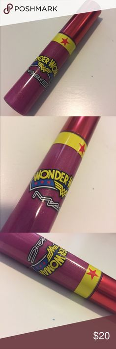 MAC Wonder Woman- Athena's Kiss In excellent condition. The label on the bottom fell off and I never put it back on.  *My products are ALWAYS AUTHENTIC. I only by from Ulta, Sephora, or the cosmetic company's website.*.       My price is firm. Bundle for discount. Thanks!! MAC Cosmetics Makeup Lip Balm & Gloss