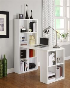 What happens when bookshelves marry desks? Get the best of both worlds with this crisp, white desk-and-double-bookshelf combination. Keep your library and supplies in easy reach while you work on the