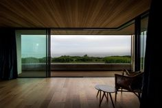 Laid vertically, the wood panels draw you to the view