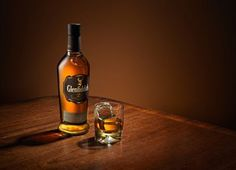 Karl Taylor whisky shoot - Classy Whisky shot on wooden table. Perfect subtle lighting and atmosphere and delicately lit label. Karl Taylor Photography, Still Life Photography, Tequila, Glenfiddich Whisky, Whiskey Bottle, Vodka Bottle, Wine Poster, Rule Of Thirds, Single Malt Whisky