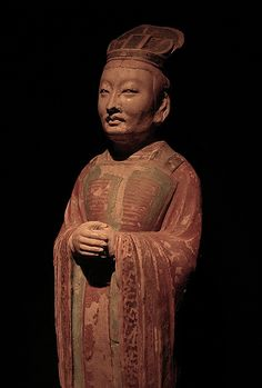 Tang Dynasty Official A Tang Dynasty (China, 618 to 906 AD) official, a clay funerary (tomb) figure.