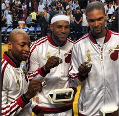 Dwayne Wade, Lebron James and Chris Bosh of the Miami heat with their 2013 Championship rings