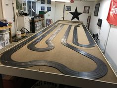 MRC, AFX 4 lane track, this sits on a 25 foot by 6 foot table, lane length is over 130 feet, its powered by an Astron power amp.
