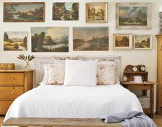 I'm not crazy about landscapes, but I love the focus on art instead of headboard.