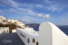 One of the best Santorini luxury hotels, located in Oia, is Atrina Canava A splendid luxury hotel in Oia, Santorini filled with the colors of the Aegean. Santorini Luxury Hotels, Oia Santorini, Santorini Holidays, Clouds, Magic, Traditional, Architecture, Amazing, Building