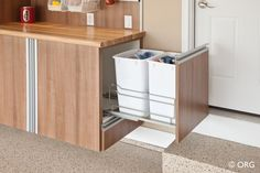 Pullout recycling bins in the garage - from the convenience of your doorstep. HomeORG.com