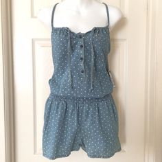 EXPRESS Denim Romper NWT!EXPRESS Denim Romper  Really cute romper with tiny white hearts. Pull on style with 2 on seam pockets, elasticized waistband and 4 button placket. The ties at top look cute just hanging or tie it into a sweet little bow. Express Pants Jumpsuits & Rompers