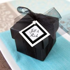 """5.30 SALE PRICE! Black Favor Boxes 2"""" square 10 boxes/pkg.. 10 boxes with lids. 2"""" square comes with a lid textured. Photo show one of the boxes ..."""