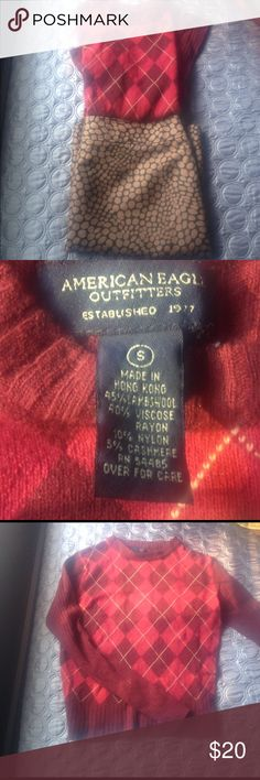 Red argyle wool cashmere blend sweater Solid deep red sleeves and back. Argyle front. Wool, rayon and cashmere blend( see pic) . Slight pilling but In good condition. American Eagle Outfitters Sweaters Crew & Scoop Necks