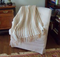 Quick and pretty blanket with a classic striped pattern using the C4tr (Cross 4 treble) stitch.