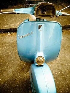 super retro Vespa with a nautical theme
