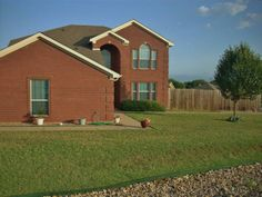 Spectacular layout huge home wonderful family oriented place to live This home has a split bedroom floor plan. Master bedroom downstairs with walk in closet and jetted tub. Four bedrooms upstairs with bathrooms between the two on each side. Living area upstairs between all four bedrooms Large sized back yard privacy fenced and a gate to let a truck through if needed. Extra large garage and oversized parking. A MUST SEE