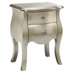 """With a bombe-style silhouette and hand-painted silver finish, artful chest offers a subtle touch of glamour to your decor. Use it to display a lush bouquet and framed photos, or stow pens and keepsakes in its 2 drawers.   Product: ChestConstruction Material: WoodColor: SilverFeatures:  Two drawersBombe silhouette Dimensions: 26.25"""" H x 19.75"""" W x 13.75"""" D"""