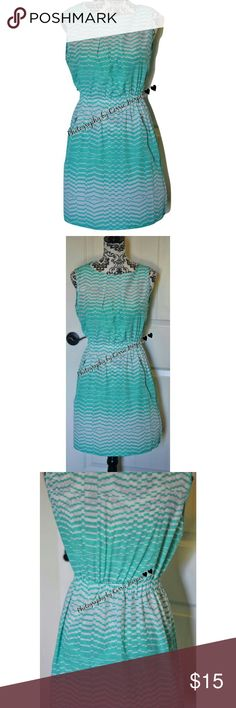Womens Spring Summer Sleeveless Dress Size M NWOT By Feathers Zippered Pockets 100% Polyester Bust 34 Inches Length 32.5 Inches Please keep in mind colors may vary depending on the device you use Smoke free, dog friendly home Dresses