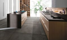 Whichever floor finish you choose in your German design kitchen, ensure that it is slip-resistant to prevent accidents. Dark Tile Floors, Dark Kitchen Floors, Grey Kitchen Floor, Grey Floor Tiles, Dark Wood Kitchens, Gray And White Kitchen, Kitchen Wall Tiles, Modern Kitchen Cabinets, Grey Flooring