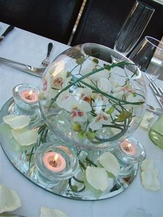 Goldfish bowl, orchid and bear grass centrepiece