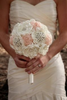 Unique, hand sewn, fabric bridal bouquet with ivory and pink flowers and an ivory ribbon wrapped handle. Rhinestone and pearl embellishments are included. This
