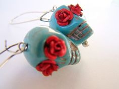 calaveras - day of the dead turquoise skull earrings with red roses.
