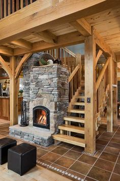 """A Russian stove."" Love the masonry and how it is incorporated with stairs."