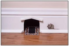 This mouse hole with rug is sweet -- I'm not crazy about the stenciled mouse though.