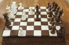 This chocolate and vanilla chess cake from Nerdy Nummies is the epitome of playing with your food. A large square yellow cake is coated in dark chocolate frosting before the chocolate chess squares are placed on top. White and dark chocol Dark Chocolate Frosting, Chocolate Candy Melts, Sweets Recipes, No Bake Desserts, Cake Recipes, Chess Cake, Cake Shapes, Dessert Decoration, Novelty Cakes