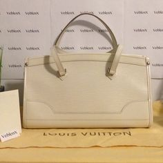 Madeleine Pm Epi Leather Hand Shoulder Bag Brand: LV Style: Madeleine  Type: Shoulder Tote Size: PM Measurements: 13 x 5.5 x 8 inches Material: Epi leather Color: Ivory  Condition: Very good  Disclosures: Minor small marks on exterior & interior lining Original sleeper bag & receipt included This item is no longer available in stores            Visit VeblenX.com for discounts! Louis Vuitton Bags Shoulder Bags