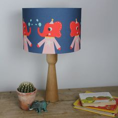 Lola Elephant Lampshade designed by Rebecca Sodergren.   Matching cushions also available!  Looks great in a child's bedroom, nursery or playroom.