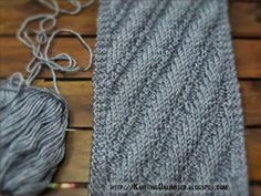 To make this diagonal stitch combines purl (P) and knit (K) stitching follow the instructions: Cast on: Multiple of 9 sts + edge stitches Row 1: edge sts, * K1, P1, K3, P4; repeat *, edge sts Row 2: