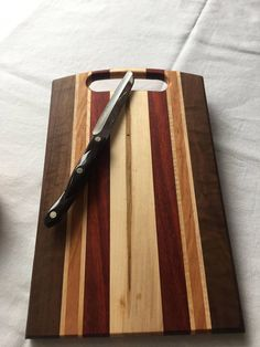 Cutting boards or serving trays are made of 5 different hardwoods, Walnut, Hard Maple, Cherry, Redheart, and Ambrosia Maple. The finish mineral oil. These boards are easy to maintain. Simply wipe mineral oil over the board. Then let dry for 24 hours and wipe off with paper towel.