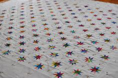 tiny wonky star quilt, all in rainbow colors, by the little red hen on flickr #quilt