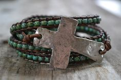 Cross and wings 'she flies with her own wings', turquoise, distressed brown leather 5x wrap bracelet, Rustic Country-Boho chic. $120.00, via Etsy.