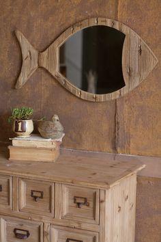 Rustic wooden fish mirror for coastal decor.