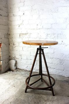Industrial Chairs and Stools, Adjustable Cast Iron & Pine Industrial Stool/Table. The circular pine top over an industrial tripod and circular base with triangular stretcher, survives from middle of the twentieth century. Table, Adjustable Stool, Furniture, Industrial Chair, Industrial Furniture, Metal Bar Stools, Table Furniture, Industrial Stool, Retro Home Decor