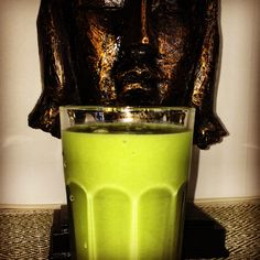 Green superjuice lunch with pear, cucumber, lime, ginger mixed with avocado.