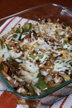 Lightly Smothered Chicken with onions, mushrooms, bell peppers, and mozzarella.