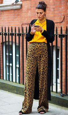 When you have an outfit as loud as leopard pants and an orange blouse, a quiet and classic cardigan is probably a good idea. In cases like this, we recommend a lengthier version to really emphasize the third-piece appeal.