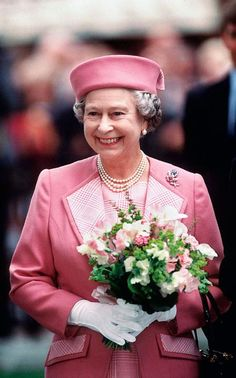 The Queen wearing a pink outfit complete with Pillbox style hat by Cornelia James, in Leicester Square, London, 1992.