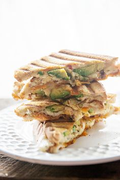 Avocado and Pesto Cheesy Panini Recipe ~ This food truck inspired panini grilled cheese recipe features fresh California Avocados, Sundried Tomato and Olive Pesto and Tomato Basil Cheddar Cheese. You won't want to miss this recipe!