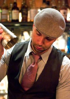 bartender uniform, hat and color tie. - get rid of the hat!! would be good management dress