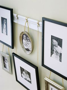For a quick-and-easy hanging solution, modify a piece of common molding to make a picture rail. Decorative golden picture hooks fitted with chain and rope display a mix of frames and add architectural interest. Use a circular link at the top of each chain to hang it over the hook.