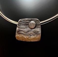 Colgante de plata hecho a mano