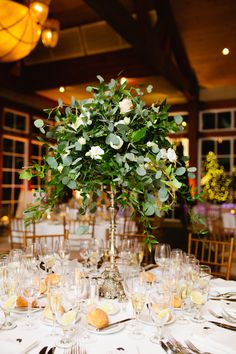 Tall wedding centerpieces make a major statement. See photos of some of the most beautiful towering centerpieces here. Tall Vase Centerpieces, Tall Glass Vases, Greenery Centerpiece, Wedding Table Centerpieces, Wedding Decorations, Floral Decorations, Centerpiece Ideas, Decor Wedding, Wedding Receptions
