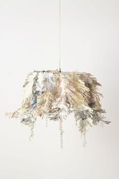 make a fringed dipped news paper chandelier