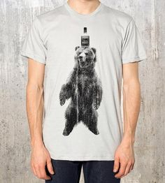 Emphasize your burliness or just flaunt your love of grizzlies and booze in this playful screenprinted t-shirt. The large graphic features a big ol' bear wearing a whiskey handle as a hat on a smooth and soft tee.