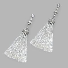 PAIR OF PLATINUM AND DIAMOND TASSEL EARRINGS.  The articulated tassels set with faceted diamond beads weighing approximately 49.75 carats, surmounted by round and rose-cut diamonds weighing approximately 5.20 carats.