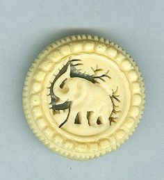 ButtonArtMuseum.com - Beautifuly Fancy Carved Pierced Ox Bone Elephant Button